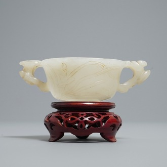 A Chinese pale celadon jade libation cup, 18/19th C.
