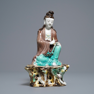 A Chinese verte biscuit figure of Buddha seated on a rock, seal mark, Republic