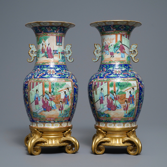 A pair of Chinese Canton famille rose vases with gilt bronze mounts, 19th C.