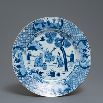 A Chinese blue and white dish with musicians in a garden, Kangxi