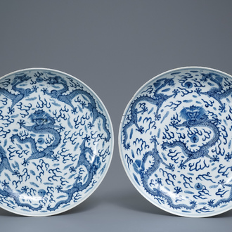 A pair of Chinese blue and white 'dragon' dishes, Kangxi mark, Guangxu