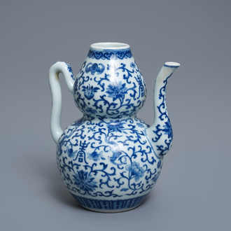 A Chinese blue and white 'bats and shou' jug, 19th C.