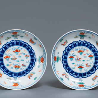 A pair of Chinese doucai 'ducks in a lotus pond' plates, four-character mark, Republic