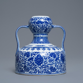 A Chinese blue and white two-handled 'lotus scroll' jug, Qianlong mark, 19/20th C.
