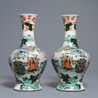 A pair of Chinese famille verte vases with figures on a terrace, Kangxi mark, 19th C.