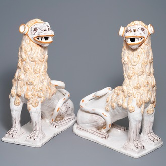 An impressive pair of large Portuguese faience models of lions, 18th C.