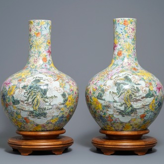 A pair of Chinese famille rose millefleurs bottle vases, Qianlong mark, 19/20th C.