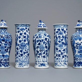 A Chinese blue and white five-piece garniture with peacocks, Kangxi mark, 19th C.