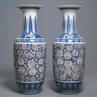A pair of large Chinese blue, white and underglaze red vases, 19th C.