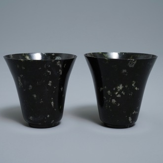 A pair of Chinese dark green jade wine cups, Qing