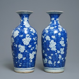A pair of Chinese blue and white 'prunus on cracked ice' vases, 19th C.
