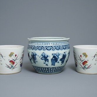 A pair of Chinese famille rose jardinières and a blue and white example, 19th C.