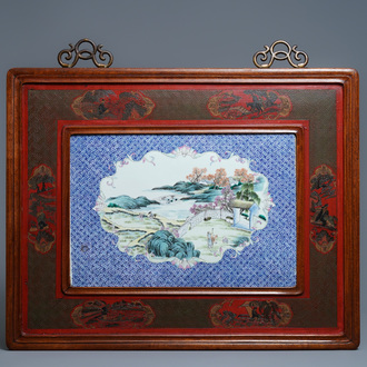 A large Chinese famille rose plaque in a lacquered wooden frame, 19th C.