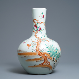 A Chinese famille rose 'peaches' vase, Qianlong mark, 19th C.