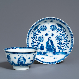 A Chinese blue and white 'mother with child' cup and saucer, Kangxi