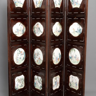 A Chinese wooden room divider with famille rose 'Romance of the Western Chamber' plaques, Republic