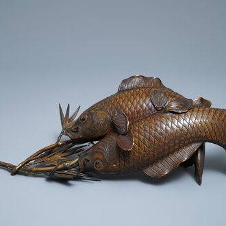 A Japanese bronze group depicting two koi fish, Meiji, 19th C.