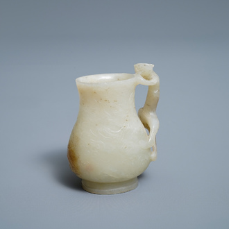 A Chinese celadon russet jade chilong-handled jug, Qing
