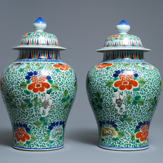 A pair of Chinese wucai vases and covers, Wanli mark, 19th C.