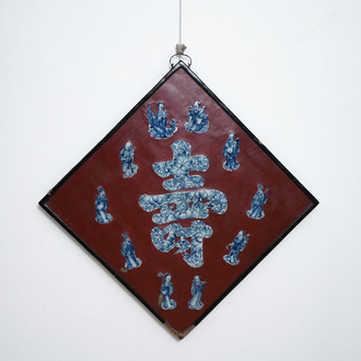 A Chinese red-lacquered plaque with blue and white porcelain inserts, 19/20th C.