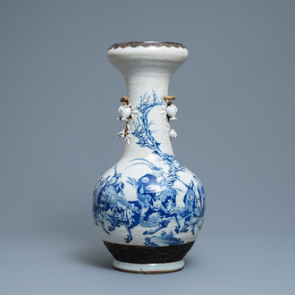 A Chinese blue, white and copper red Nanking crackle-glazed vase, 19th C.