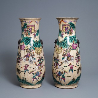 A pair of Chinese Nanking famille rose vases with warriors, 19th C.