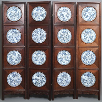 A Chinese wooden room divider with blue and white 'dragon' plaques, 19th C.
