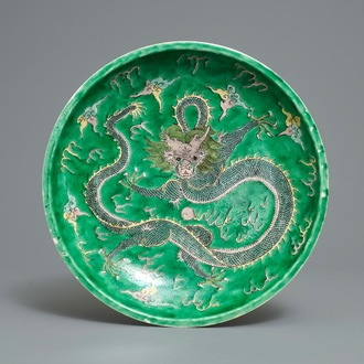 A Chinese verte biscuit 'dragon' charger, Kangxi mark, 19th C.