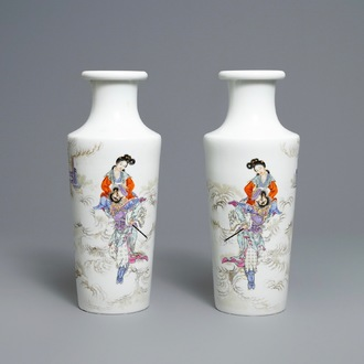 A pair of Chinese famille rose rouleau vases, four-character mark, 20th C.