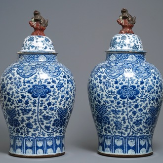 A pair of Chinese blue and white vases with faience replacement covers, Kangxi