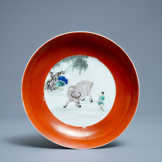 A Chinese famille verte coral-ground 'buffalo shepherd' plate, Yongzheng mark and of the period