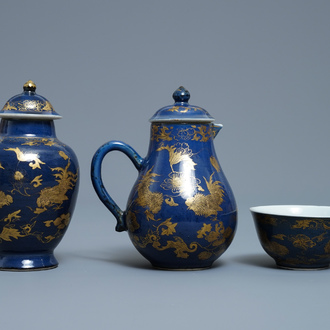 A Chinese gilt-decorated powder blue cream jug, a tea caddy and a tea bowl with roosters, Yongzheng