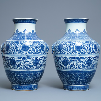 A pair of Chinese blue and white hu vases with floral scrolls, Qianlong mark, 19th C.