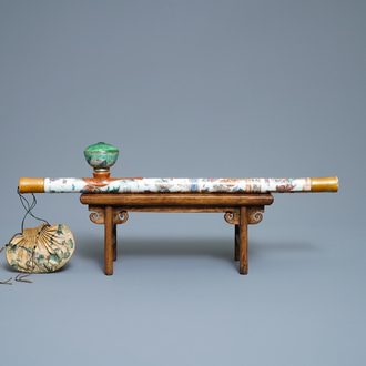 A Chinese famille rose opium pipe with silk pouch, 19th C.