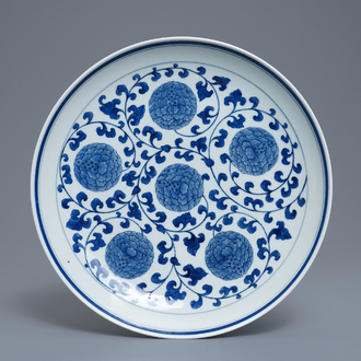 A Chinese blue and white 'peony scroll' dish, marked 'Made in Jingdezhen in 1955'