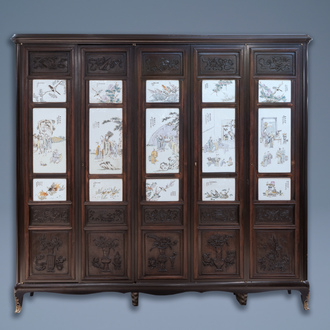 A Chinese wooden closet with 23 qianjiang cai plaques, 19/20th C.