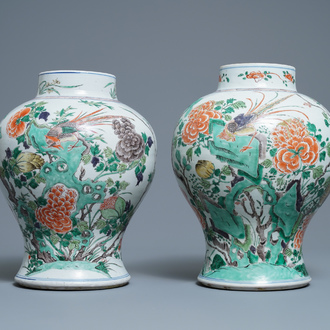 A pair of Chinese famille verte vases with birds and insects, Kangxi