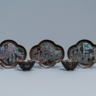 Three Chinese lac burgauté saucers and two cups, Kangxi