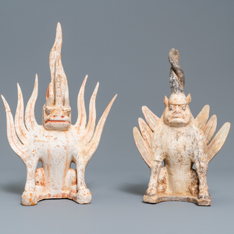 A pair of Chinese painted pottery models of 'earth spirits', Tang
