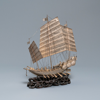 A large Chinese silver model of a junk on carved wooden stand, 19th C.