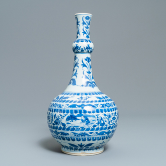A Chinese blue and white bottle vase with figural medallions, Transitional period
