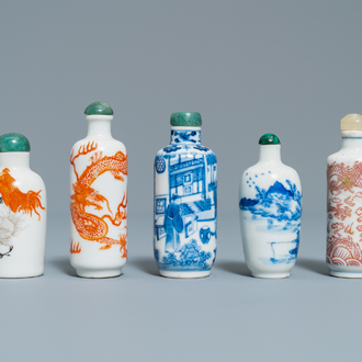 Five Chinese blue and white, iron- and copper-red snuff bottles, 19th C.
