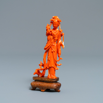 A Chinese carved coral figure of a lady with lingzhi, 19/20th C.