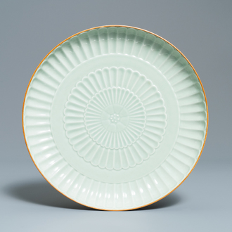 A Chinese celadon-glazed 'chrysanthemum' charger, Jingdezhen, dated 1954