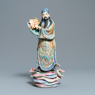 A Chinese famille rose figure of an immortal, 19/20th C.