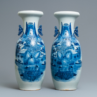 A pair of Chinese blue and white 'landscape' vases, 19th C.