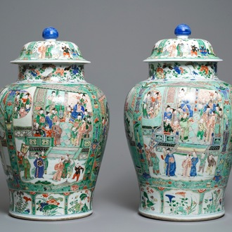 A pair of large Chinese famille verte vases and covers, Kangxi