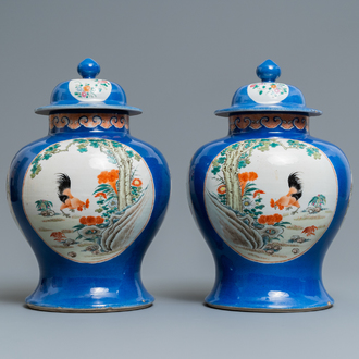 A pair of Chinese famille rose vases and covers, Qianlong mark, 19th C.