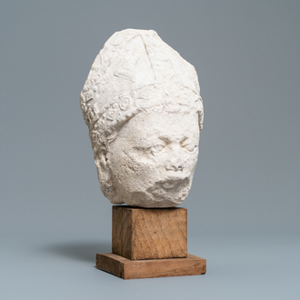 A French carved stone head of a bishop, 14/15th C.