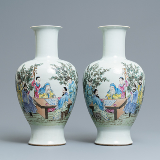 A pair of Chinese famille rose vases with go-players, Qianlong mark, 19/20th C.